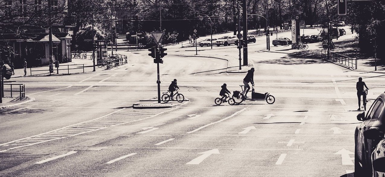 Bicycle Riders Crossing Road