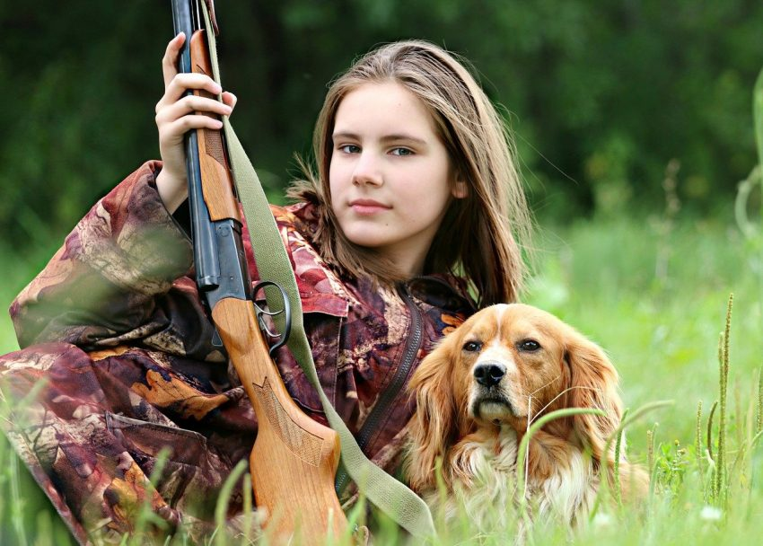 Female Hunter with Dog