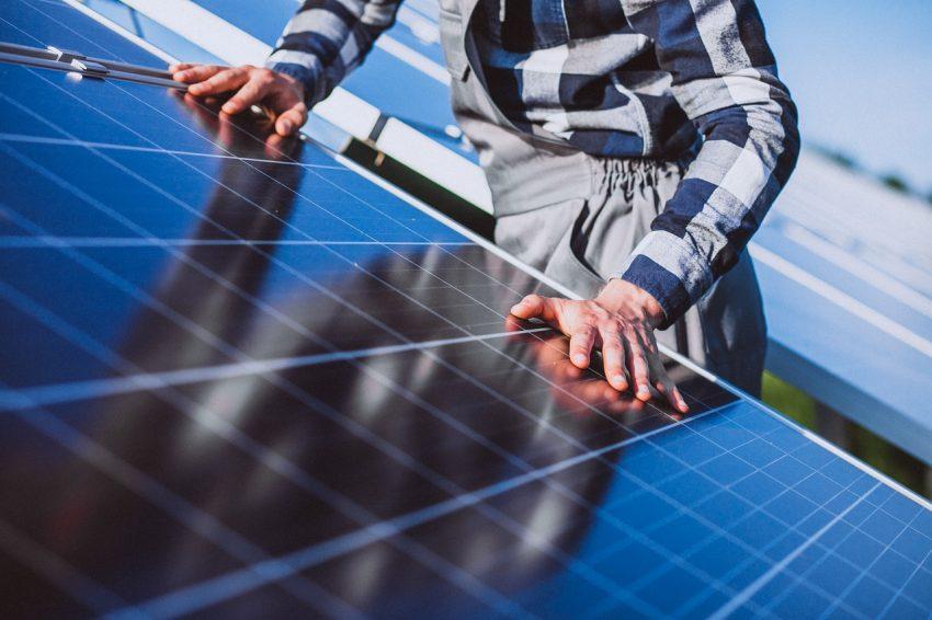 Man Placing Solar Panel